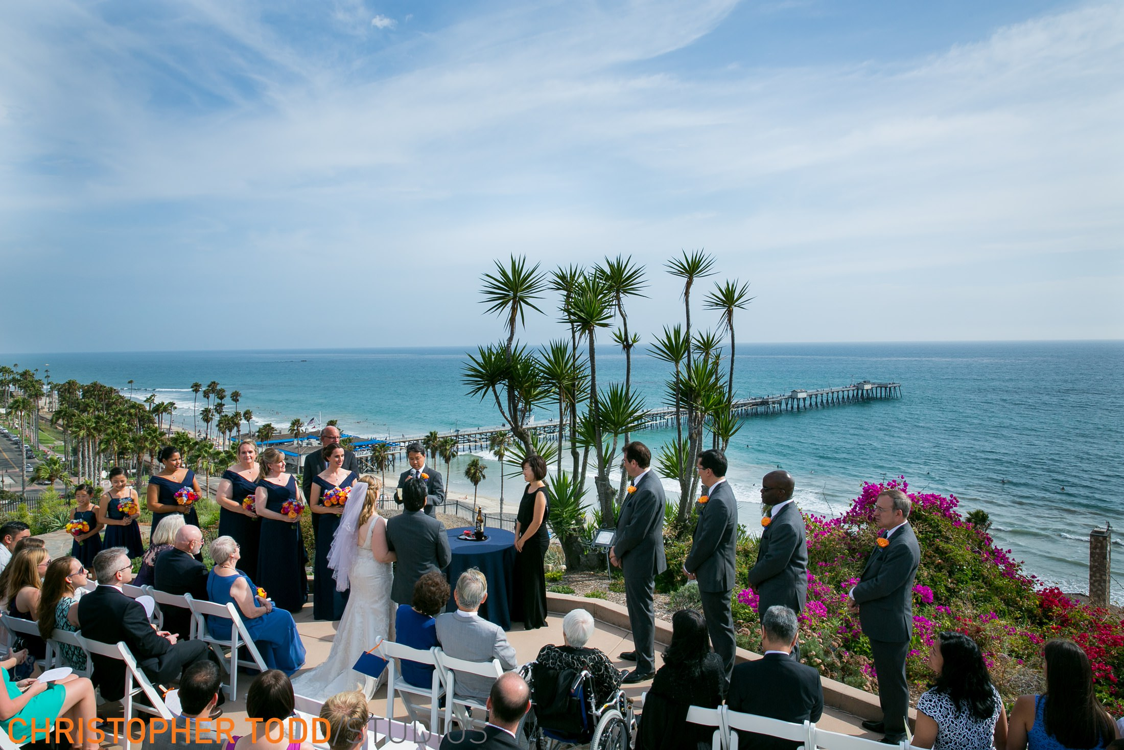 Beautiful outdoor wedding ceremony at Casa Romantica in Orange County overlooking the ocean and San Clemente Pier.