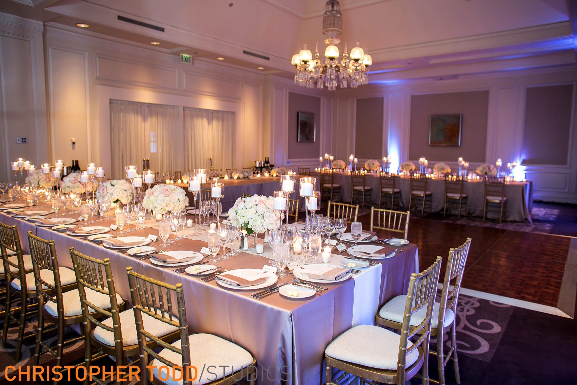 reception with long tables and white cushion chairs with gold backing at ritz laguna niguel.