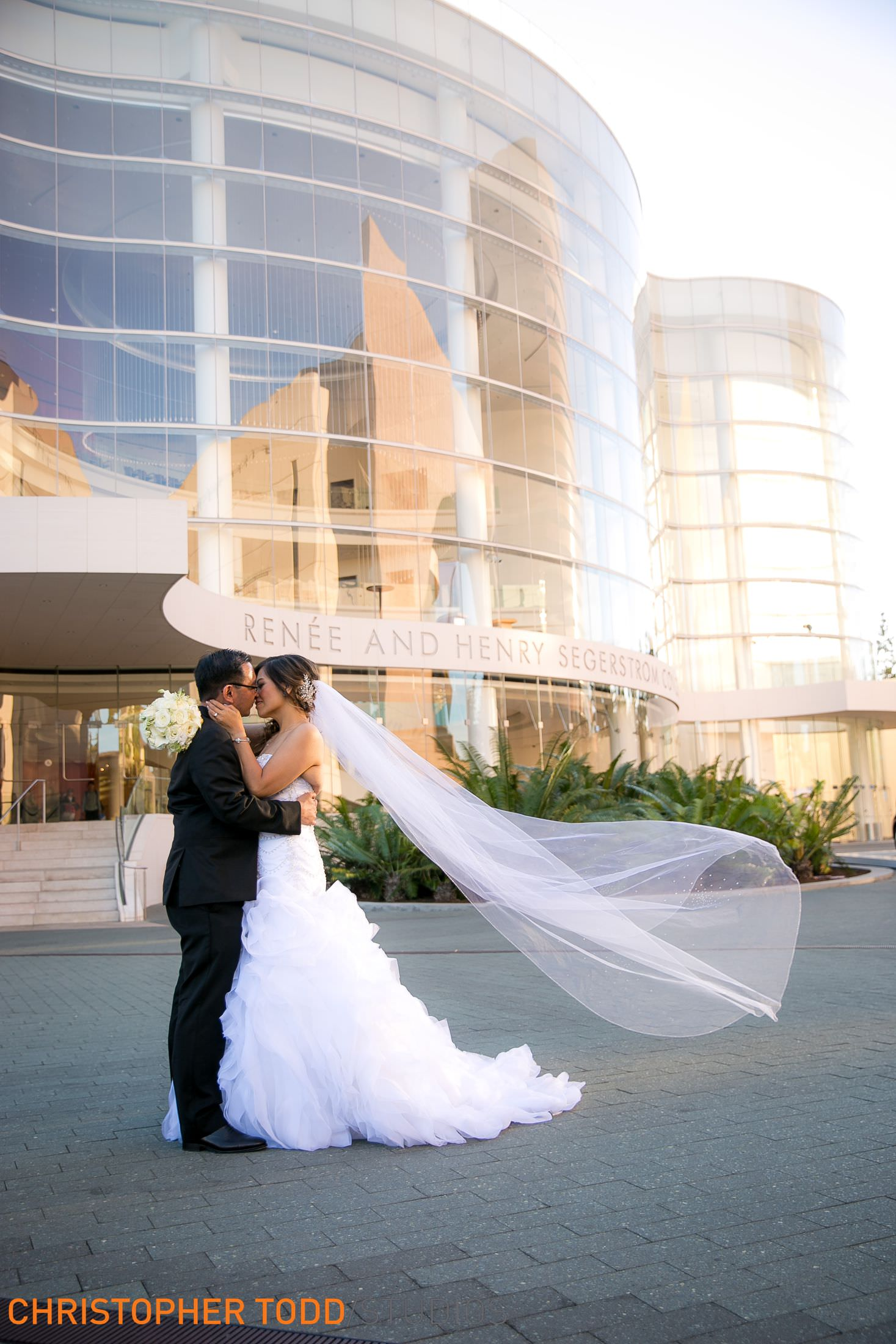 segerstrom concert hall in the background of the bride and groom portrait