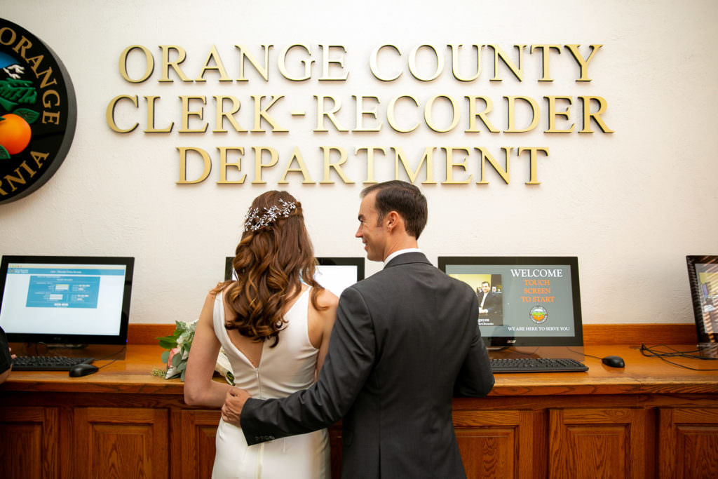 couple registering before their civil ceremony at the old orange county courthouse