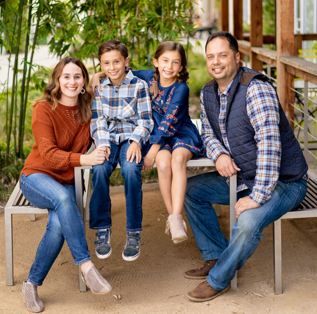 Family wearing fall colors for portraits at the oc mix in orange county