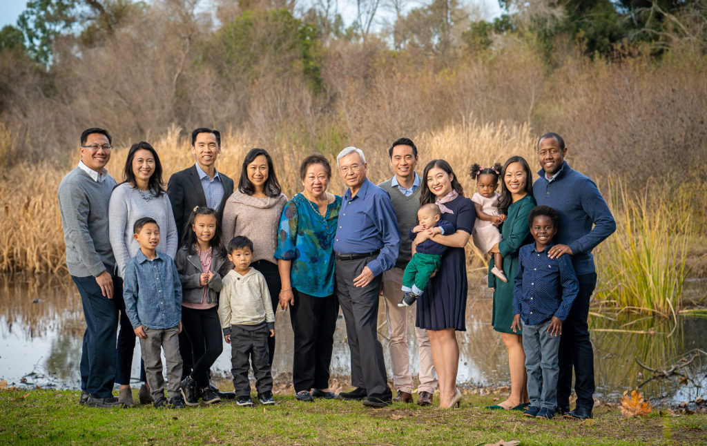large family portrait during reunion at park with lake in huntington beach