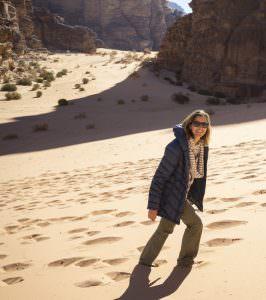 ilana walking up sand dunes in wadi rum desert traveling on vacation in jordan