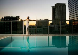 bride at pool rooftop wedding venue in los angeles