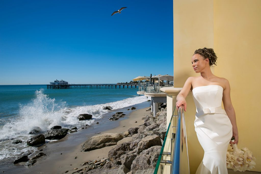 bride readies herself for upcoming waterfront wedding in orange county
