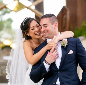 bride and groom laugh after wedding on steps of wayfarers chapel