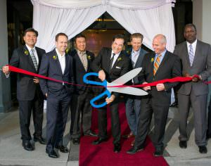 ribbon cuttting at orange county grand opening event