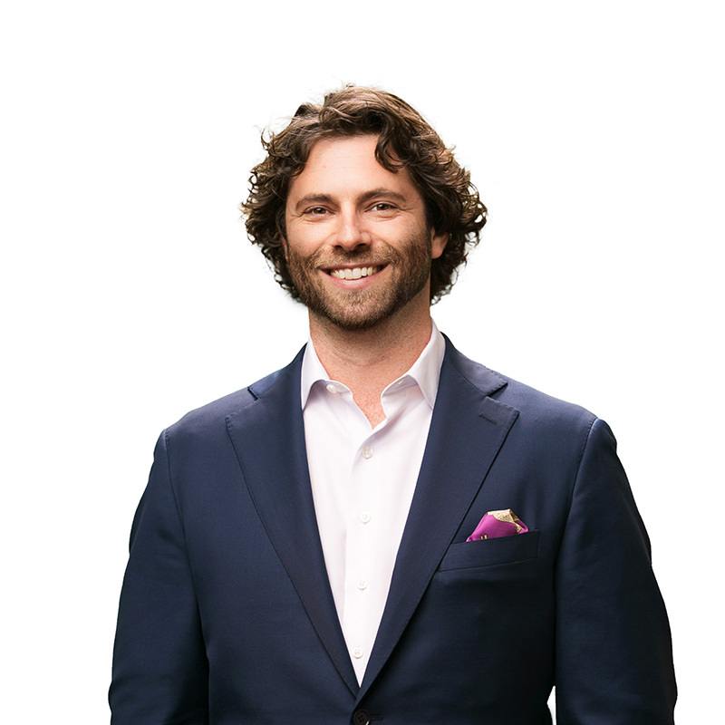 executive portrait of young ceo in suit with pocket square