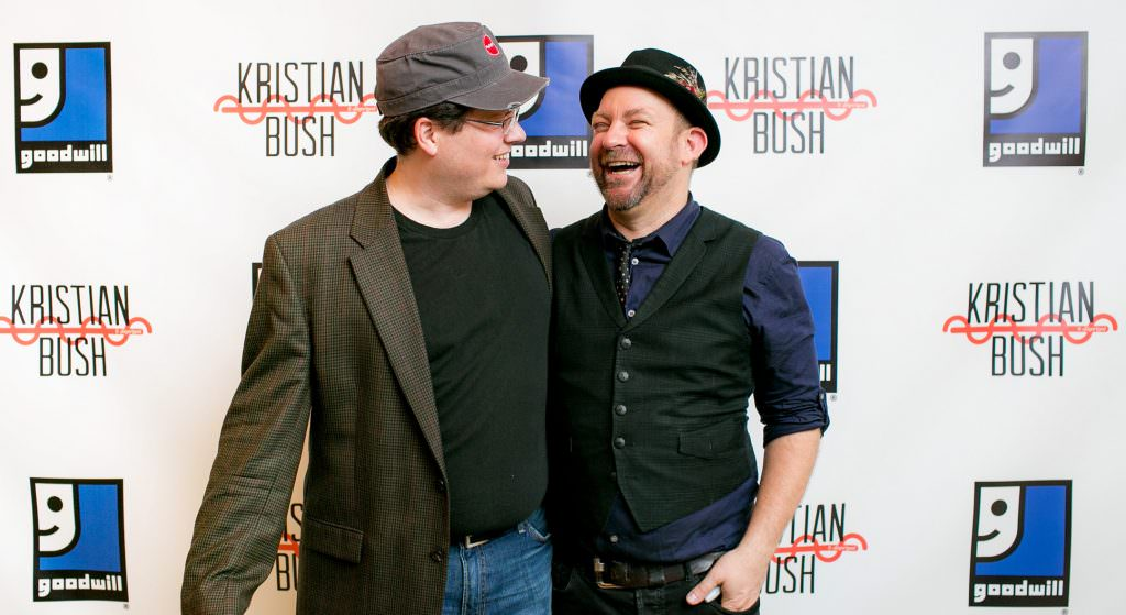 men laugh for photo at step and repeat at orange county charity event