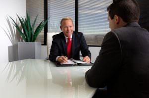 headshot of executive at his desk