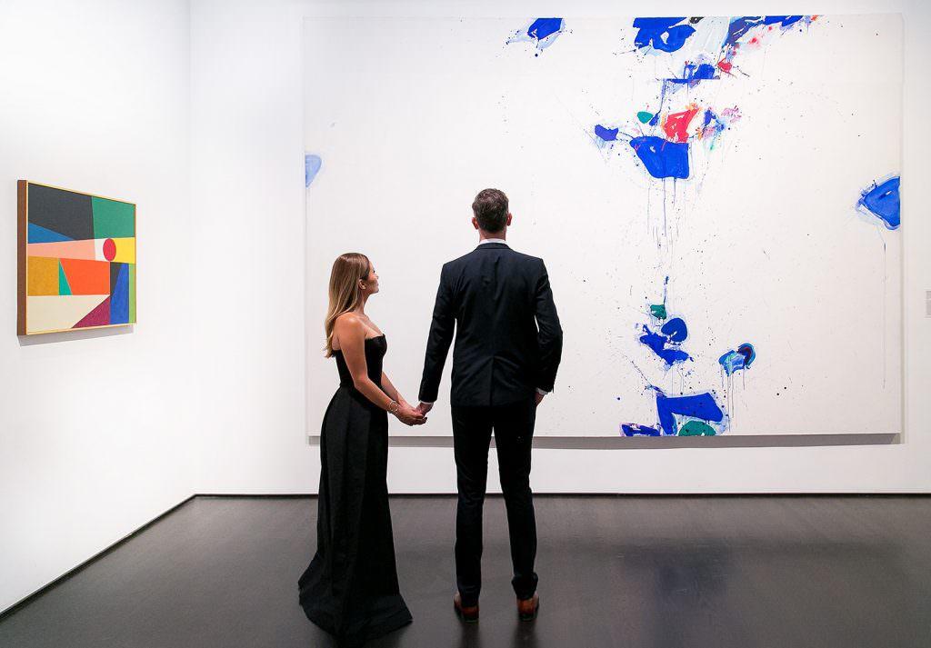 bride and grrom celebrate wedding at modern art gallery