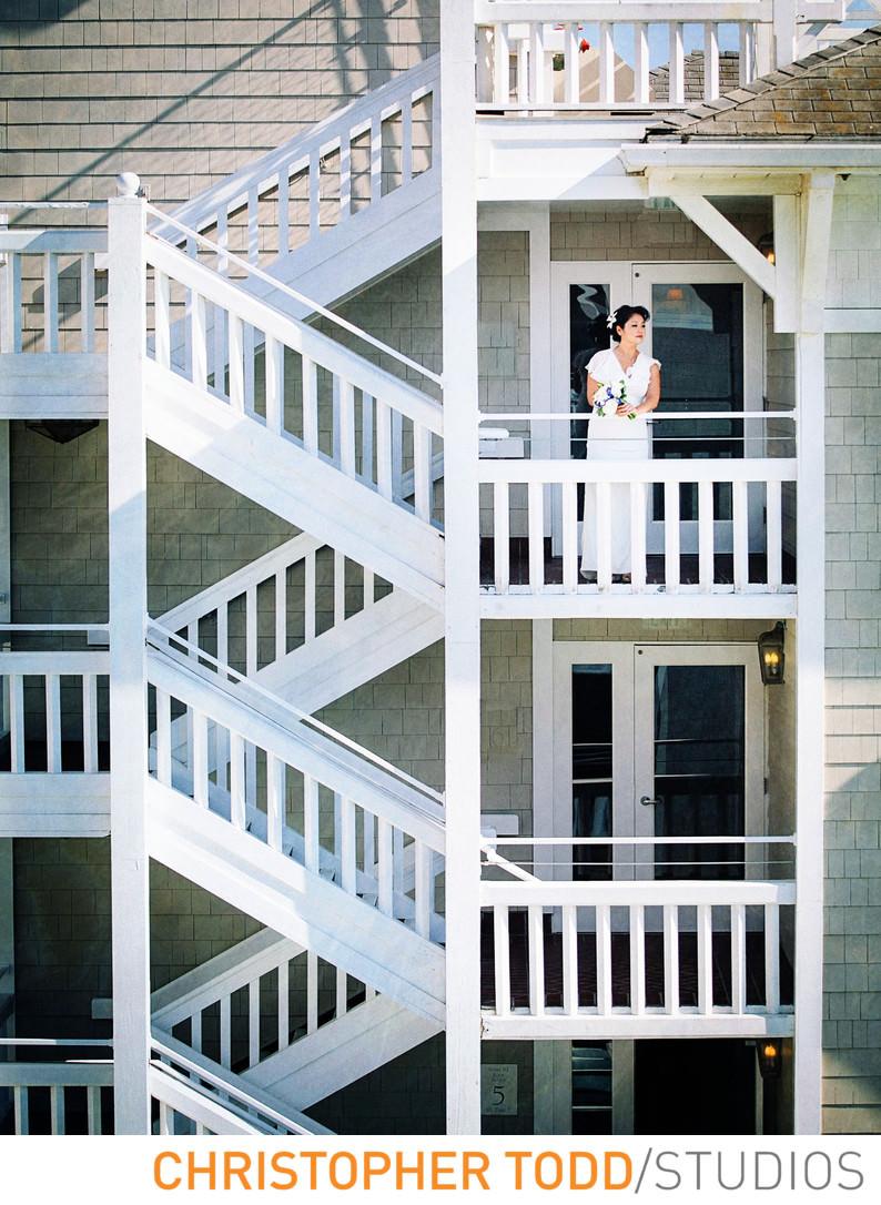 portrait-bride-stairs-shutters-beach-hotel