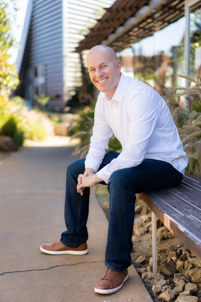 online dating profile photo of guy sitting on bench